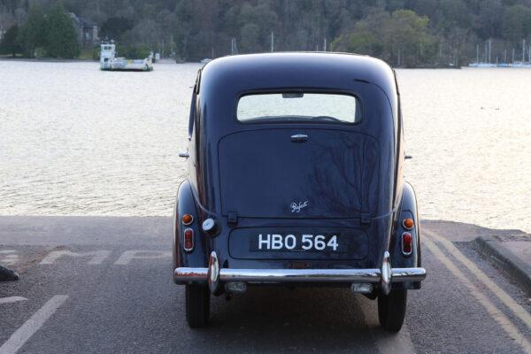 Charles-Ashworth---1953-Ford-Prefect-at-Hawkshead-ferry,-Windermere.